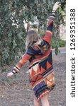 hippy girl dancing outside | Shutterstock . vector #1269351388
