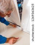 mature handyman is opening the... | Shutterstock . vector #1269363625