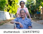 senior woman caring man on...   Shutterstock . vector #1269378952
