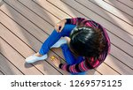 top view of girl sitting on a... | Shutterstock . vector #1269575125