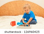 little boy with touch pad at... | Shutterstock . vector #126960425