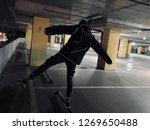 acrobat in the parking lot | Shutterstock . vector #1269650488