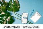 flat lay. monstera leaves... | Shutterstock . vector #1269677038