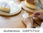 female cooking cake in home... | Shutterstock . vector #1269717112
