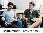 positive students sitting in... | Shutterstock . vector #1269754558