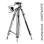 black camera with tripod on a... | Shutterstock .eps vector #1269762475