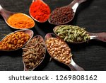 spices in spoons on black...   Shutterstock . vector #1269808162