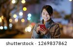 woman check on smart phone in... | Shutterstock . vector #1269837862