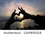 two hands making heart on the...   Shutterstock . vector #1269850318