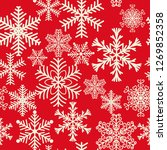 seamless pattern of snowflakes... | Shutterstock . vector #1269852358