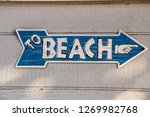 Blue Arrow Shaped Sign With...