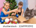 two girls pull christmas toys... | Shutterstock . vector #1269993592