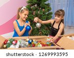 two girls are considering balls ... | Shutterstock . vector #1269993595