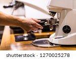 barista grinding coffee beans... | Shutterstock . vector #1270025278