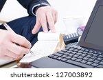 a business man writing a bank... | Shutterstock . vector #127003892