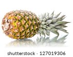 Pineapple on the side with reflection isolated on white background - stock photo