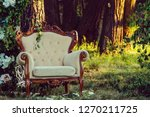 white armchair on nature... | Shutterstock . vector #1270211725