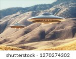 Two unidentified flying objects - UFO, flying over the sunny desert. 3D illustration.