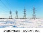 electrical pylons in the snow.... | Shutterstock . vector #1270298158