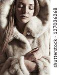 beautiful lady in a fur   Shutterstock . vector #127036268