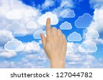 Cloud computing concept with woman hand - stock photo