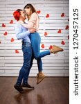 young happy couple with heart... | Shutterstock . vector #1270457125