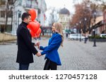 a loving couple in a coat with... | Shutterstock . vector #1270457128