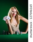 woman in casino playing cards | Shutterstock . vector #127046165
