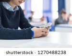 young female student using a... | Shutterstock . vector #1270488238