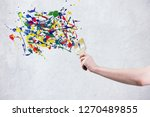 a hand holding paintbrush...   Shutterstock . vector #1270489855