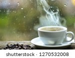 Stock photo wet glass window and cup of hot coffee autumn cloudy weather better with caffeine drink enjoying 1270532008
