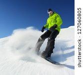 Snowboarder On Piste In High...