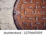 Rusty Metal Grease Trap Cover...