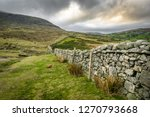Stock photo this is a stone wall running up the mourne mountains in northern ireland it is near hares gap 1270793668