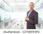happy business man portrait at...   Shutterstock . vector #1270859392