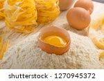 raw yellow italian pasta... | Shutterstock . vector #1270945372
