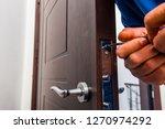 old age repairman in blue... | Shutterstock . vector #1270974292