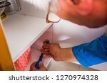 old handyman is fixing the... | Shutterstock . vector #1270974328