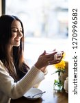 happy young woman drinking...   Shutterstock . vector #1270996582