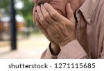 aged retired man crying close... | Shutterstock . vector #1271115685