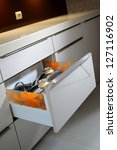 Stock photo drawer with pots in modern kitchen 127116902