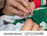 view of mother filling baby's...   Shutterstock . vector #1271224438