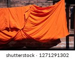 texture of orange robe of a...   Shutterstock . vector #1271291302