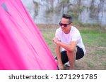 an asian man in white t shirt...   Shutterstock . vector #1271291785