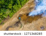 Aerial view of deforestation.  Rainforest being removed to make way for palm oil and rubber plantations - stock photo