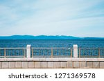 Small photo of Sea beyond the fence in Vladivostok, Russia