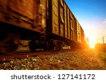 dusk  motion blur freight train. | Shutterstock . vector #127141172