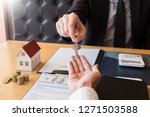 estate agent giving house keys... | Shutterstock . vector #1271503588