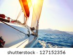 yacht sailing against sunset.... | Shutterstock . vector #127152356