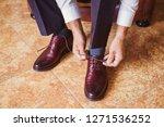 businessman wearing brown... | Shutterstock . vector #1271536252
